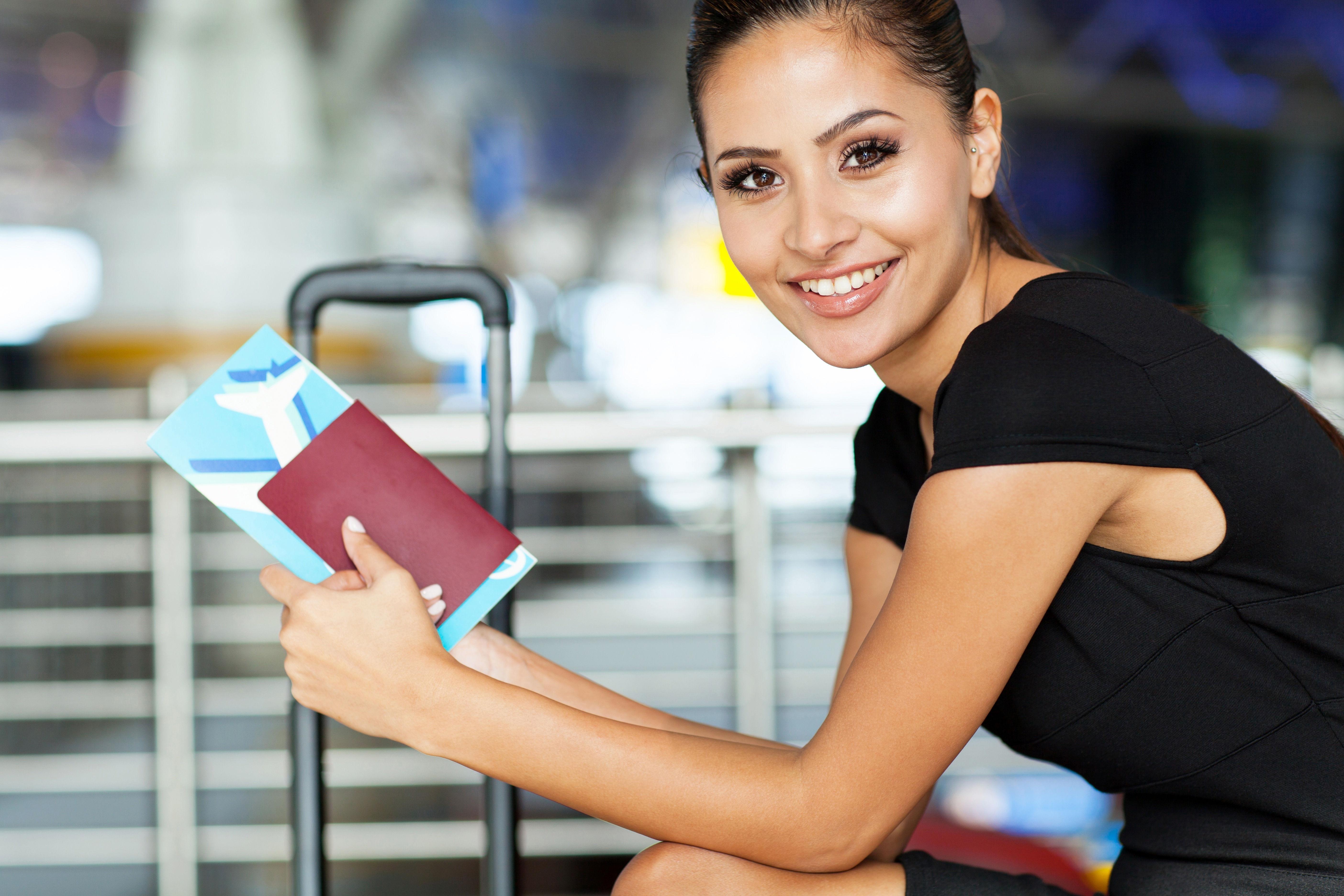 Girl waiting for flight having UK Passport