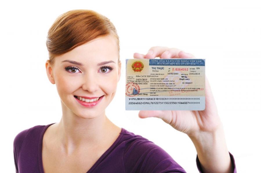 Girl holding Vietnam Visa