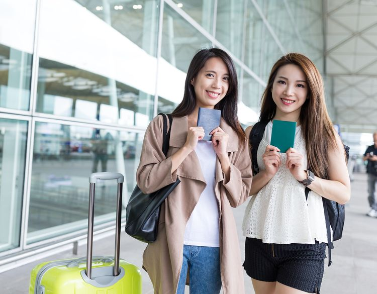 Travelling Friends holding their passport