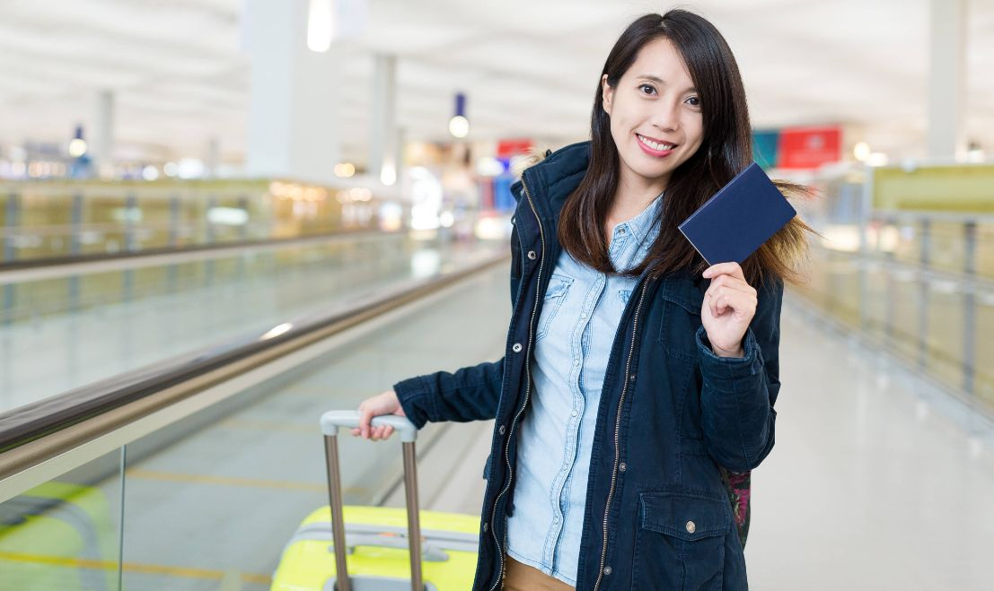 Woman go traveling at international airport with passport