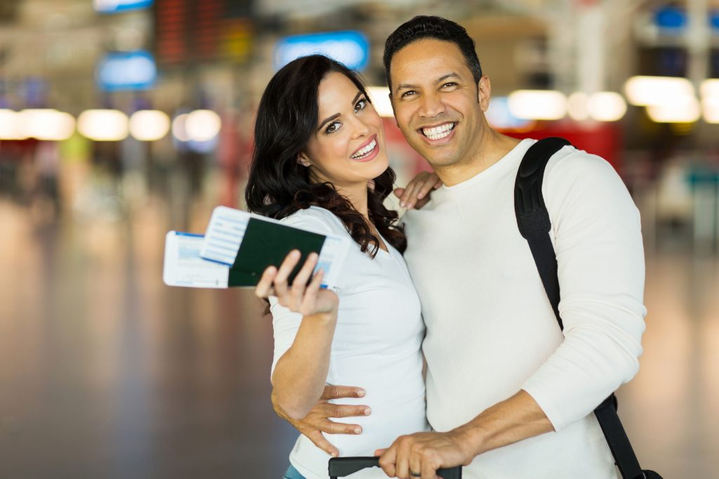 Couples with Passport on their hand