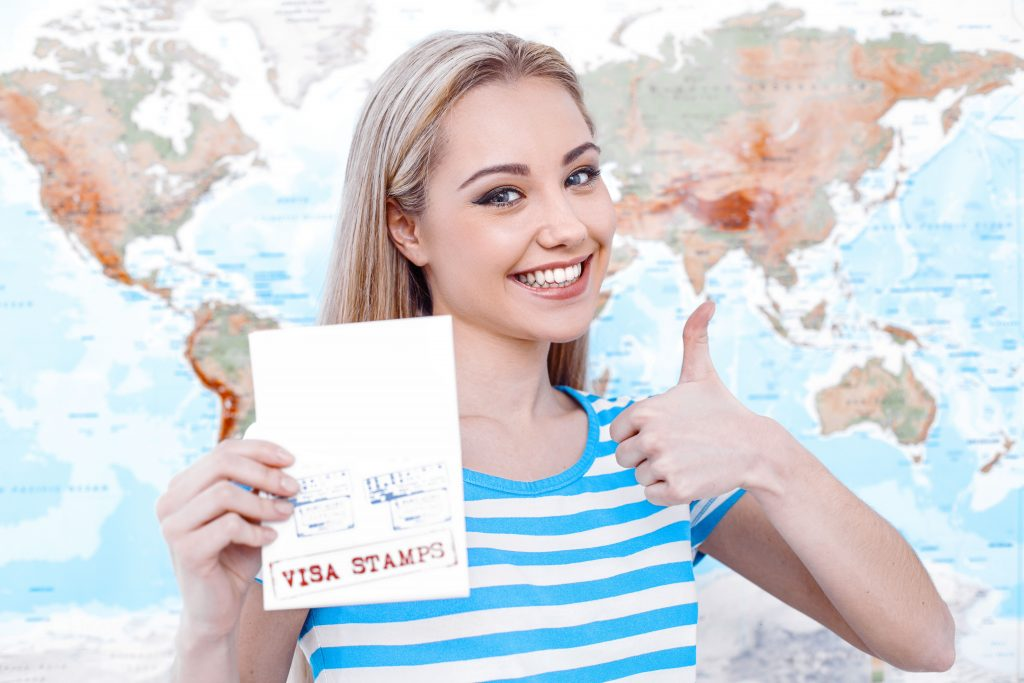 Girl holding the passport