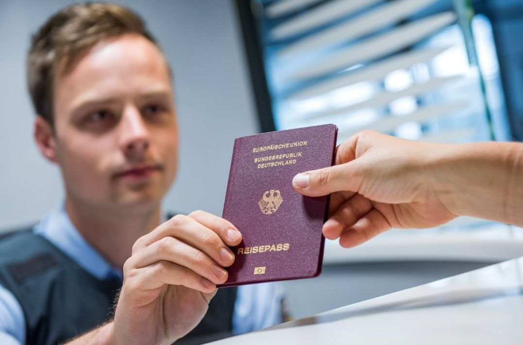 Airport Officer getting the Passenger Passport