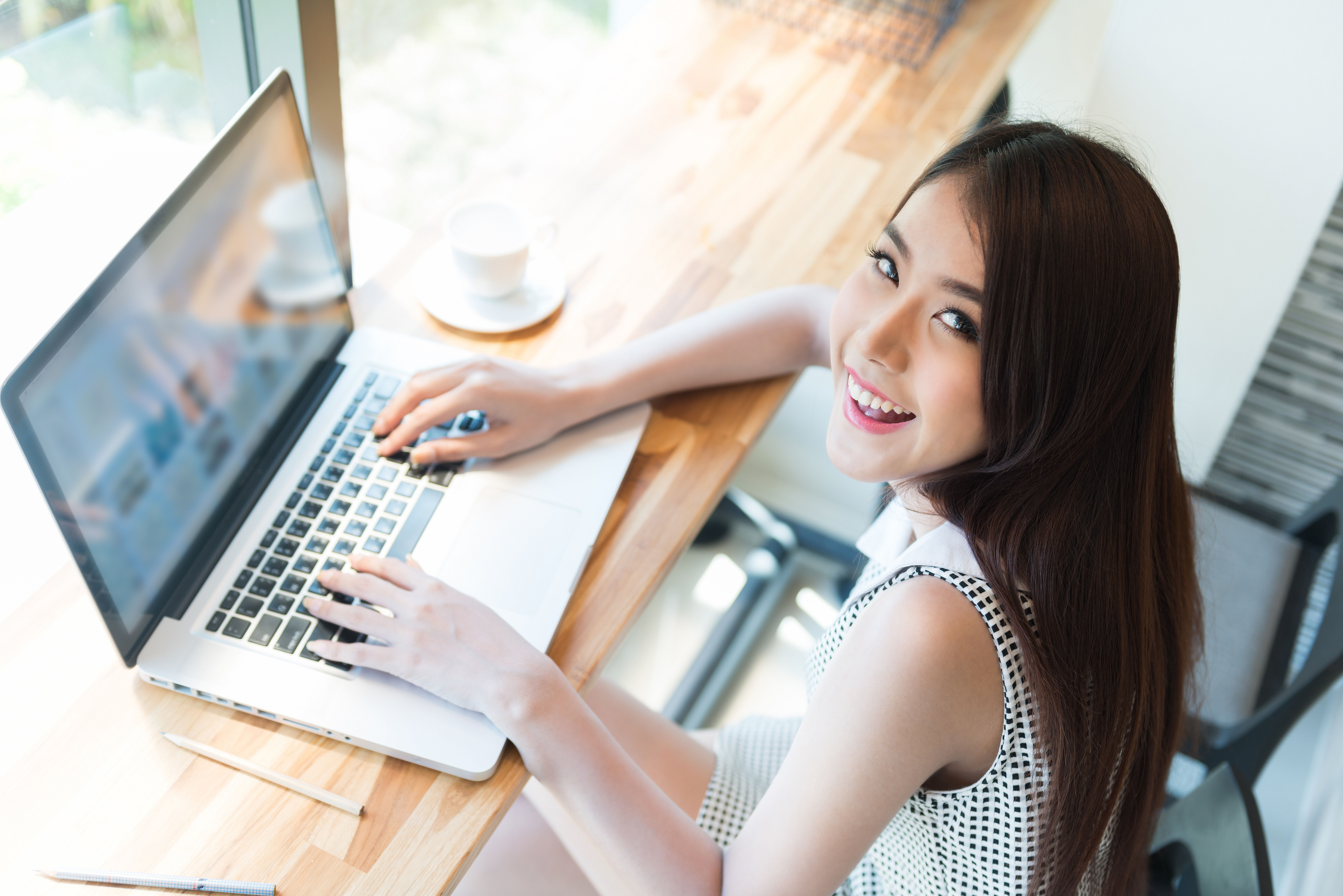 Beautiful business woman using a laptop
