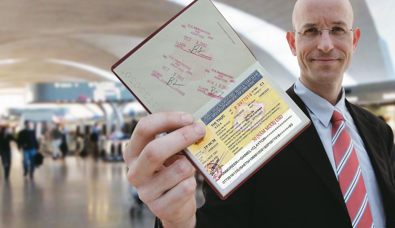 Man holding and showing Vietnam visa