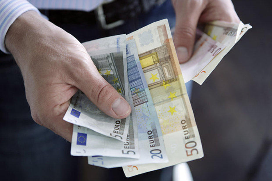 Men with Euro Currency