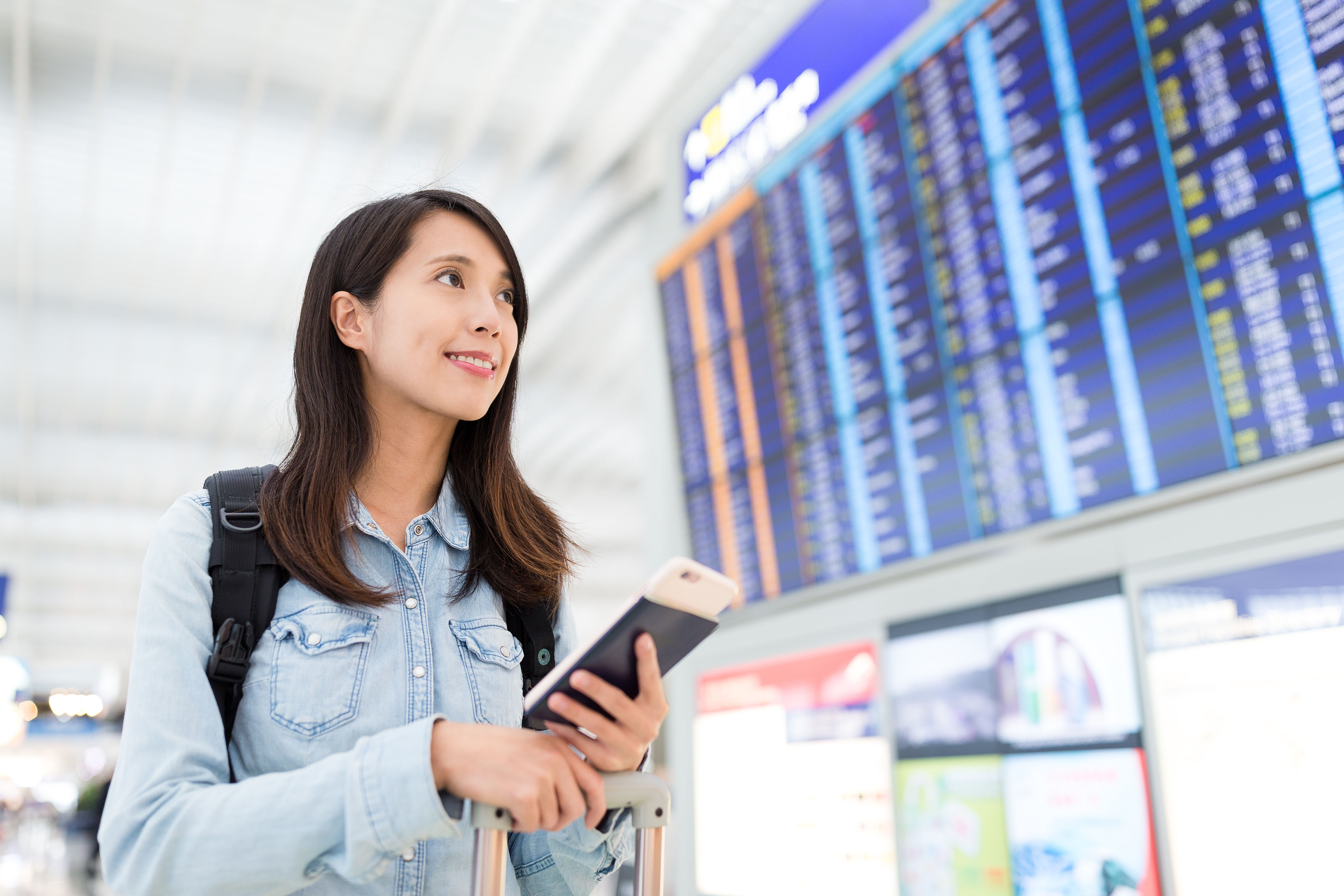 Woman checking on display screen at the airport