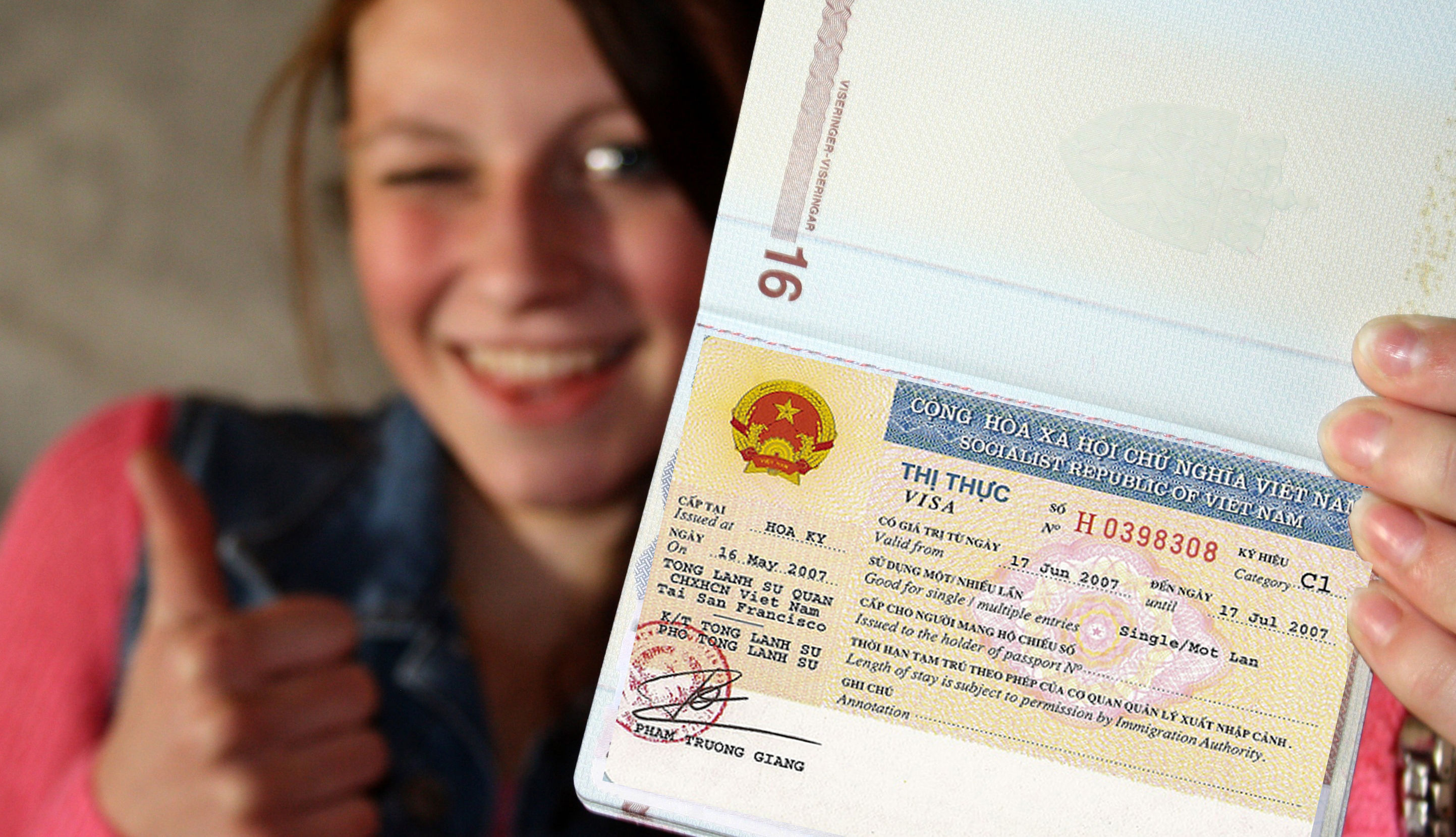 Woman holding the Vietnam Visa