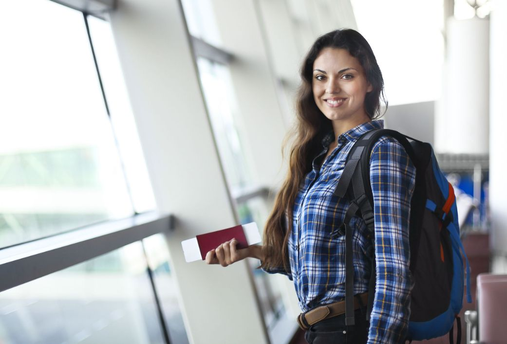 Woman passenger at the airport with passport