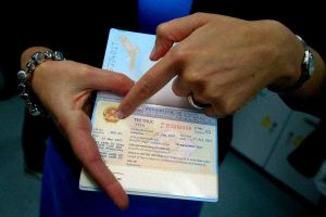Women having the Vietnam Visa in hand