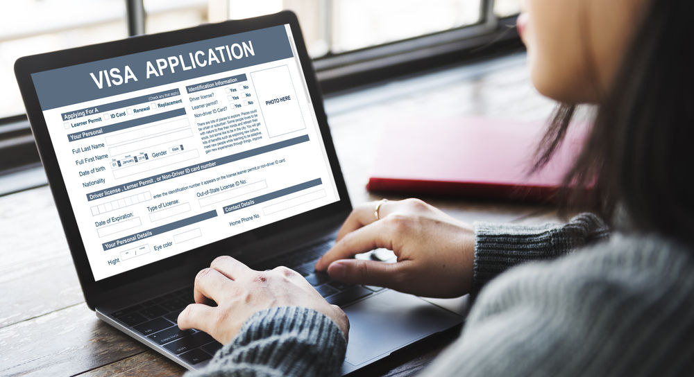 Women with Laptop applying for Online Visa Application
