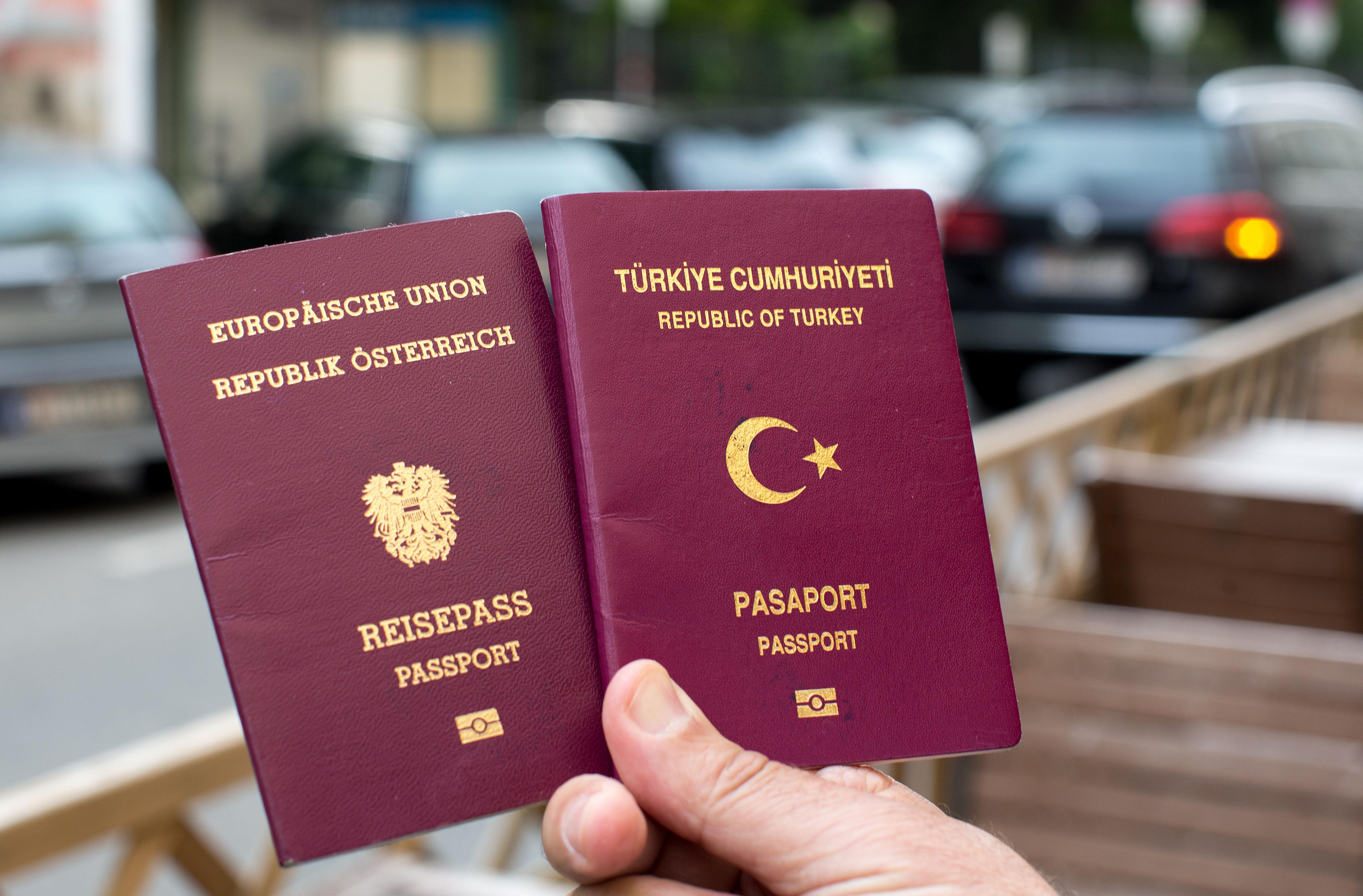 Austria and Turkey passport holding in hand