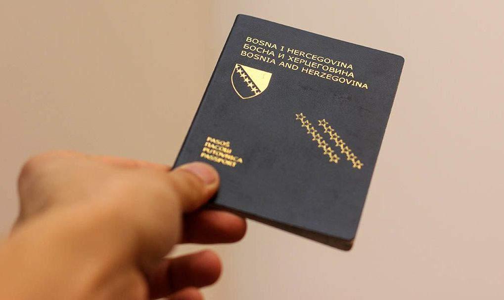 Bosnia and Herzegovina Citizens Passport Holding in hand