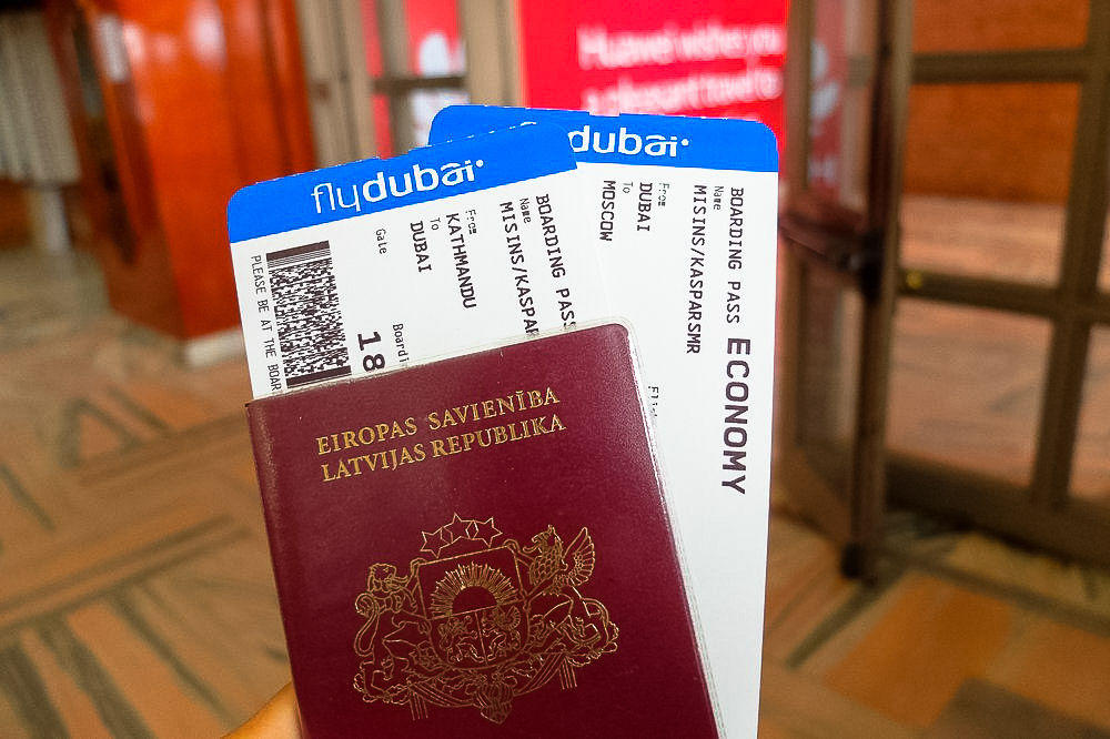Latvian Passport with air tickets