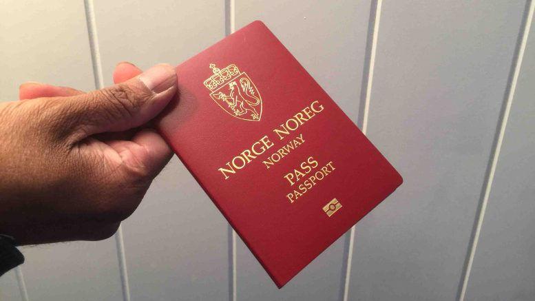 Man having the Norway passport in hand