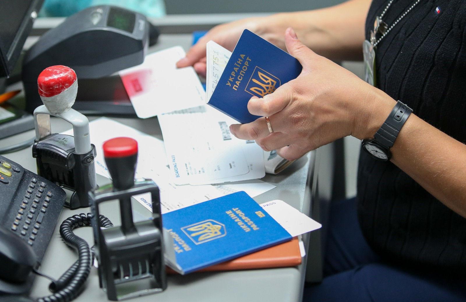 Passport Officer Checking the Ukraine Passport