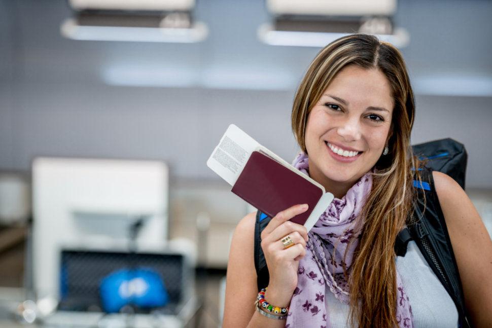 Smiling Women having the Passport in hand