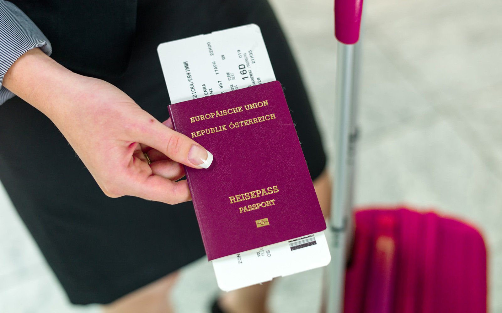 Women having the Austria Passport and her suitcase