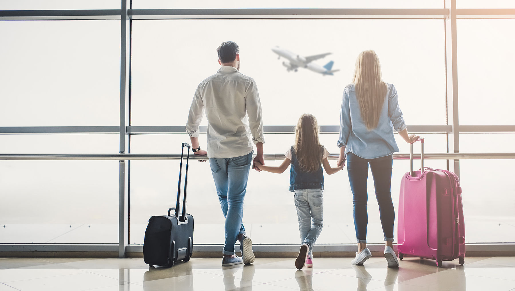 Family in Airport ready for travel