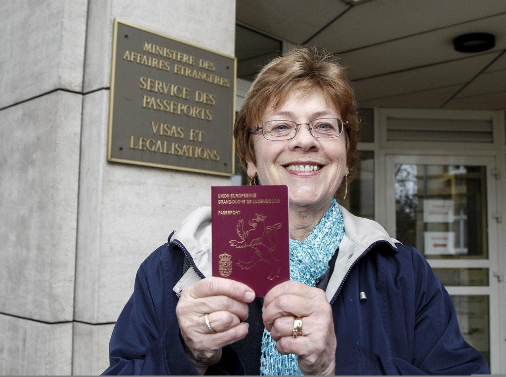 Luxembourg Women holding the Luxembourg passport
