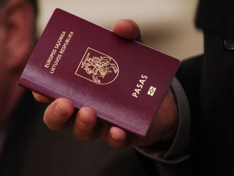 Person holding the Lithuania Passport