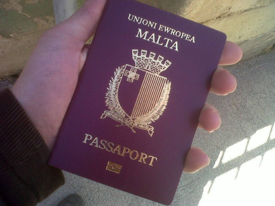 Person holding the malta passport